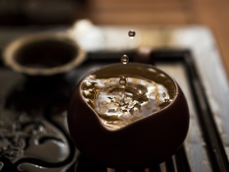 Pouring of Exquisite Green Tea from Teapot at Traditional Chinese Tea Ceremony. Chaban - Set of Equipment for Drinking Tea 스톡 콘텐츠