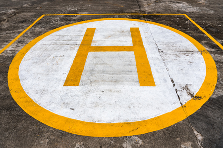 Sign on Concrete surface. Helipad for helicopter landing