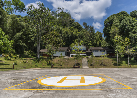 Helipad for helicopter landing surrounded with lush green jungles Stock Photo