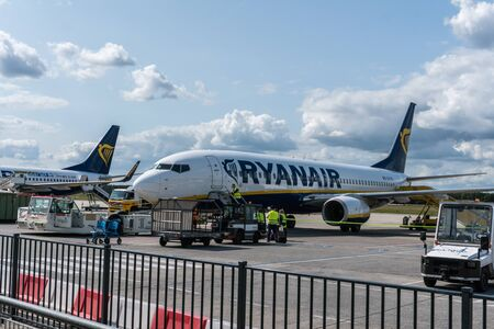 EINDHOVEN, THE NETHERLANDS - AUG 25, 2018: Ryanair aircraft on the runway. Ryanair is a major company for low cost flights.