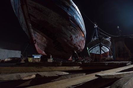 Wooden ships Vessel in a Dock at night - shipyard in Essaouira, Morocco. Dockyard of Atlantic Ocean