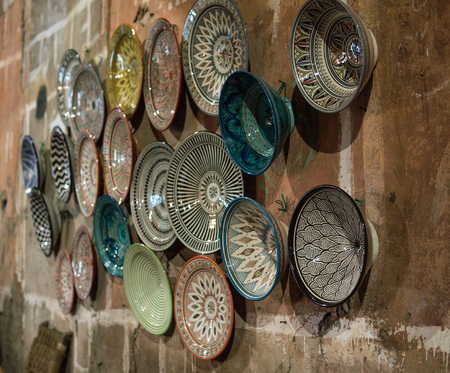 Traditional ceramic pottery on the wall of Morocco bazaar, Marakesh