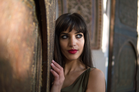 Portrait of Beautiful Middle Eastern African Moroccan Girl in Picturesque Dar Si Said Riyad in Marrakech