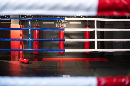 White and Red ropes of Boxing Ring in Gym Фото со стока