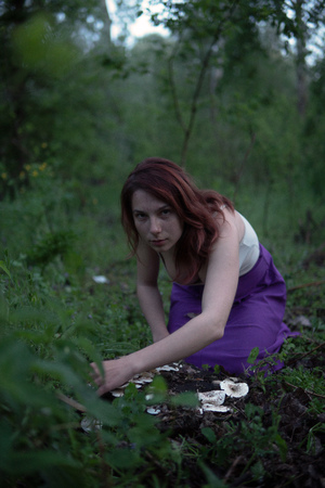 Young Beautiful Attractive woman in Purple Skirt in the forest with a mushroom at Mysterious Twilight 写真素材