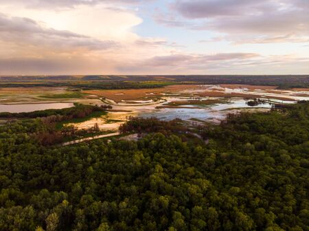 Sunset River Aerial Landscape Cinematic Drone Footage. Flying above Dniestr river in Ukraine or Moldova with forests and fields around