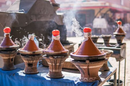 Authentic food of Morocco - traditional Tajine in steam vapor on an outdoor barbecue at town square on the street in Morroco Stok Fotoğraf