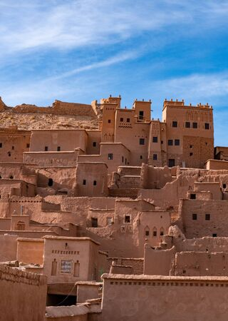 The fortified town of Ait ben Haddou near Ouarzazate on the edge of the sahara desert in Morocco. Atlas mountains. Used in many films such as Lawrence of Arabia, Gladiator Standard-Bild - 131306805