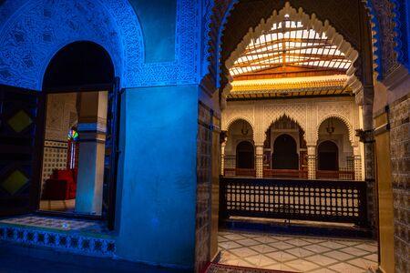MARRAKESH, MOROCCO - JAN 2019: Moroccan architecture traditional arabian design - Rich Riyad arch mosaic interior