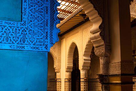 MARRAKESH, MOROCCO - JAN 2019: Moroccan architecture traditional arabian design - Rich Riyad arch mosaic interior detail Редакционное
