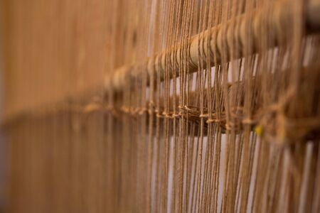 Old style tool for weaving a carpet with traditional techniques on a loom, in the privat family manufacture in Atlas mountains in Tinghir, Morocco