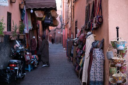 Morocco, Marrakesh - January 2019: Small street in Marrakechs medina old town. In Marrakech the houses are traditionally pink. Morocco Редакционное