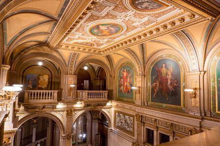 VIENNA, AUSTRIA - OCTOBER 2019: Interior of Vienna State Opera House. Wiener Staatsoper stairs, fresco and rich gold interior