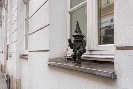 Dwarf on the street windowsill in Wroclaw city, Poland Фото со стока