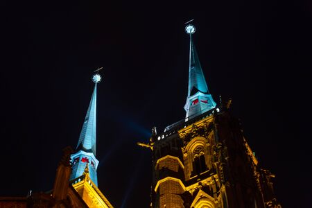 Wroclaw. View at night of the historical district Ostrow Tumski with the spires illuminated of the cathedral of St. John the Baptist