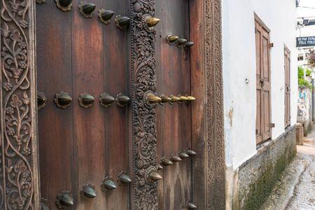 Traditional carved wooden door in Stone Town, Zanzibar.