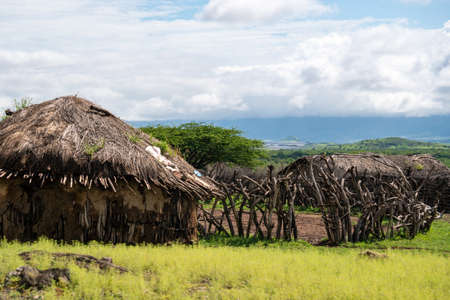 Traditional Maasai Village with Clay Round Huts in Engare Sero area near Lake Natron and Ol Doinyo Lengai volcano in Tanzania, Africa