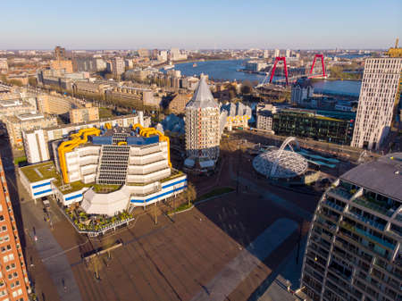 ROTTERDAM, THE NETHERLANDS - MARCH 2020: View at Most Expensive living buildings in Rotterdam, The Netherlands. Unusual Designed Architecture near the Central railway Station