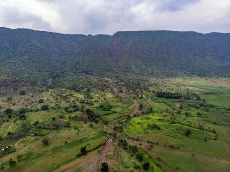 Evening time Aerial View on the Ngorongoro Crater, the worlds largest intact caldera. Conservation Area in Northern Tanzania