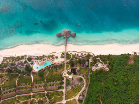 Top View on Beautiful thatch stilt house restaurant and Resort at Zanzibar Kendwa beach at evening time in Turquoise Water of Indian ocean