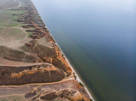 Aerial Shot of clay hills with canyons near the Black sea at Misty Autumn weather. Stanislavs mountains, Kherson region, Ukraine