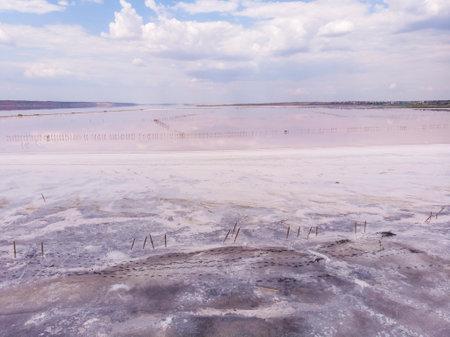 White Salt Shores of Red Kuyalnik Liman in Ukraine, Odessa at Summer