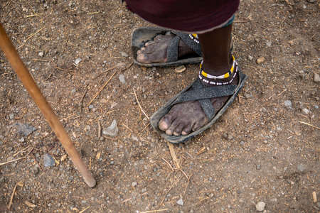 Recycled tires become a Maasai mans sandals in Tanzania, Africa