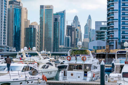 Dubai, UAE - February 2020: Boats in the bay of Dubai Marina with skyscrapers on background 新聞圖片
