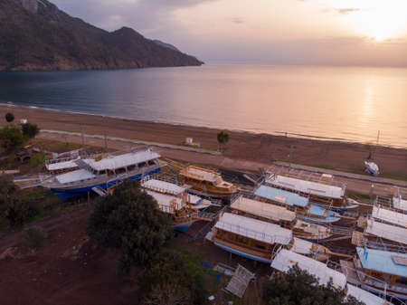 Aerial Shots of Adrasan. Boats are waiting for the High Season While Standing on the Ground Seaside view from Adrasan Beach along the Mediterranean coast in Kemer, Antalya Province, Turkey 版權商用圖片