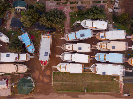 Boats are Concervated and Standing on the Ground Near Adrasan Beach. Aerial Shot