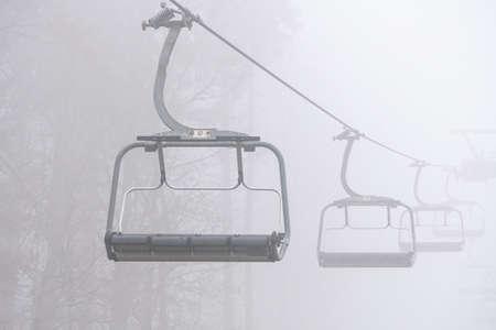Ski lift in the fog. Ski resort in Bukovel, Ukraine