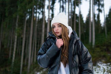 Beautiful Young Woman in Winter Woods. Warm Clothing 版權商用圖片