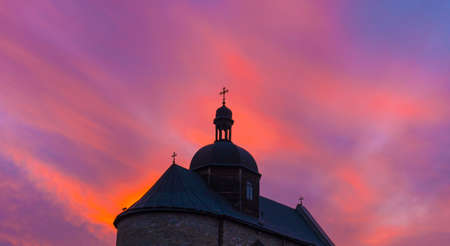 Orthodox Church in Kamyanets-Podilsky in Ukraine at SUnset Sky Background