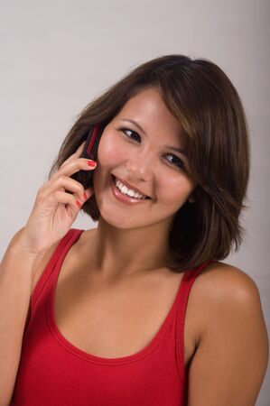 A beautiful young woman talking her cell phone photo