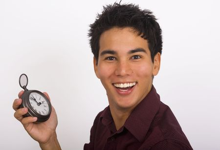 A young Asian American man holds a clock in his hand and smiles Stock Photo - 4357396
