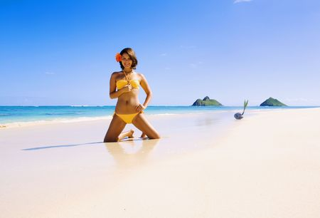 young Polynesian girl in bikini on a Hawaii beach with a flower in her hair Stock Photo - 4371087