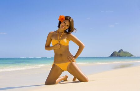 young Polynesian girl in bikini on a Hawaii beach with a flower in her hair Stock Photo - 4371086