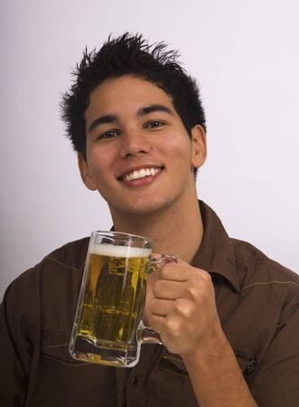 A young Asian American man enjoys a glass of beer Stock Photo - 4371088