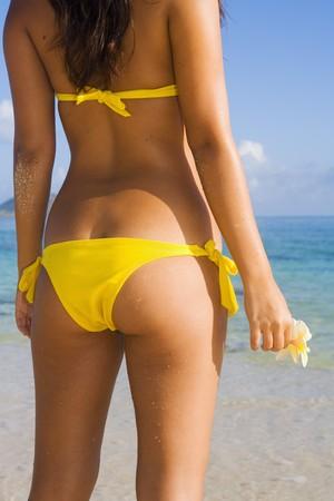 polynesian: rear view of beautiful young  local woman on the beach in lanikai,hawaii