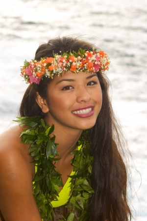 magma: hawaiian girl with flowers on lava cliffs by the ocean Stock Photo