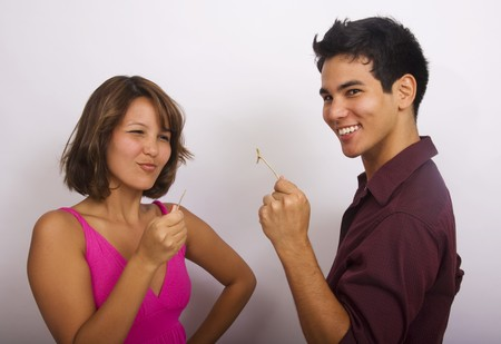 Two Asian American siblings pull on a wishbone Stock Photo - 4399632