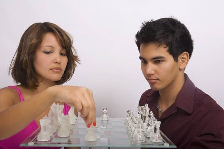 Two Asian American siblings playing a game of chess Stock Photo - 4399649
