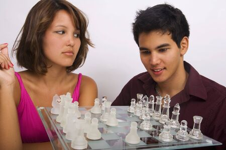Two Asian American siblings playing a game of chess Stock Photo - 4399667