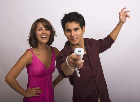 Two Asian American siblings playing a video game Stock Photo - 4399627