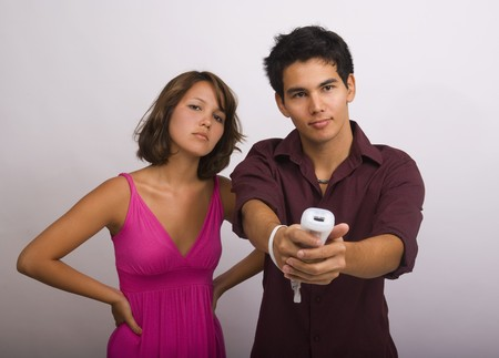 Two Asian American siblings playing a video game Stock Photo - 4399626
