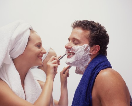 a young woman shaves her husband