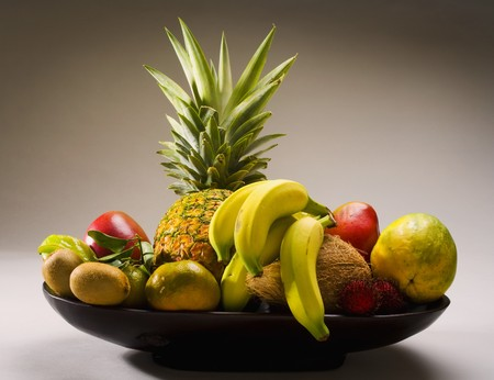 A selection of tropical fruits from Hawaii, including pineapple,kiwi,papaya photo