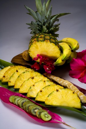 A selection of tropical fruits from Hawaii, including pineapple,kiwi, photo