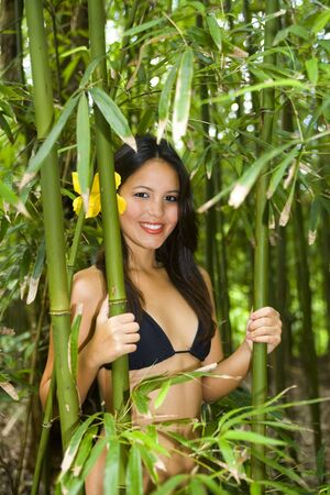 beautiful young polynesian woman in a bamboo forest Foto de archivo
