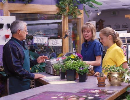 mother and daughter buying plants at a garden shop